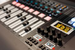 Multi-channel digital audio mixing console. Close up view of multichannel digital audio mixing console. Selective focus Royalty Free Stock Photos