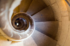 Close up view at narrow stone spiral stairway Stock Images