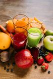 Close-up view of natural smoothies in glasses and fresh ingredients. On table royalty free stock photography