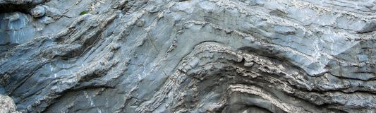 Close up view of natural wavy rochy formation. Abstract rough design. / background royalty free stock image
