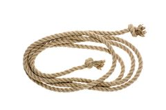 Close-up view of nautical rope with knots. Isolated on white stock photography