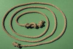 Close-up view of nautical rope with knots. On green royalty free stock images