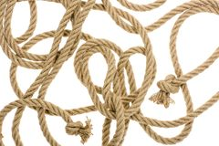 Close-up view of nautical rope with knots. Isolated on white stock images
