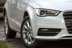 Close-up view of a new modern car parked on the side of the stre. Et Royalty Free Stock Photo