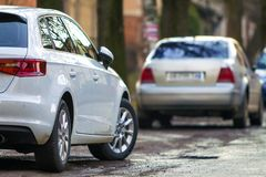 Close-up view of a new modern car parked on the side of the stre. Et Stock Photography