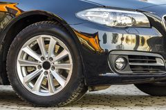 Close-up view of a new modern car parked on the side of the stre Royalty Free Stock Photos
