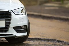Close-up view of a new modern car parked on the side of the stre. Et Royalty Free Stock Images