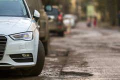Close-up view of a new modern car parked on the side of the stre. Et Stock Photo