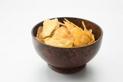Bawl filled with corn chips on white back. Close up view of nice wooden bawl filled with corn chips on white back royalty free stock photos