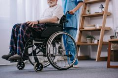 Close-up view of nurse standing behind senior man royalty free stock image