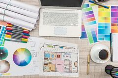 Free Close Up View Of Color Palette Swatch And House Building Plans On Office Desk With Laptop And Cup Of Coffee For Break Royalty Free Stock Photo - 185293885