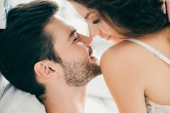 Close-up View Of Seductive Happy Young Couple Able To Kiss In Foreplay Stock Photo