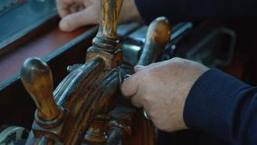 Close up view of old boat cabin. With steering hand wheel and dashboard inside stock footage