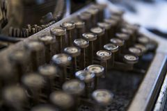 Close up view on an old dirty broken antique typewriter machine keys with Cyrillic symbols letters. stock photo