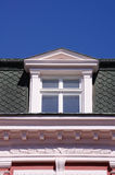 Close up view of old dormer window on the roof Stock Photo