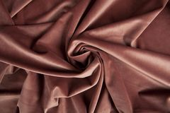 Fabric pink velvet. Close-up view of an old pink velvet curtain. Minimal color still life photography stock images