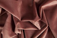 Fabric pink velvet. Close-up view of an old pink velvet curtain. Minimal color still life photography stock photos