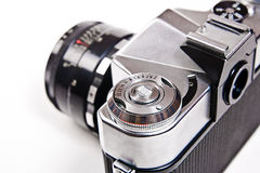 Close up view of old retro photo camera on white background. Royalty Free Stock Photos