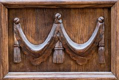 Close up view of an old, rustic, massive, wooden, door with deco Royalty Free Stock Images