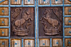 Close up view of an old, rustic, massive, wooden, door with deco Stock Photography
