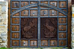 Close up view of an old, rustic, massive, wooden, door with deco stock photo