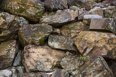 Rock wall background. Old stone wall texture and background. Stock Photography