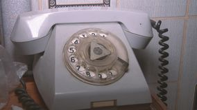 Close-up view on old telephone dial. The view on old phone dial. Old dusty telephone. dirty and dusty phone stock video