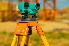 Close up view on old theodolite on construction place Stock Photo