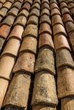Close-up view of old vs. new roof tiles, Dubrovnik. Rows of neatly aligned terracotta roof tiles in Dubrovnik`s Old City. Several new tiles show the aging of the royalty free stock photography
