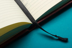 Close-up view of open books with bookmark.  Royalty Free Stock Photo