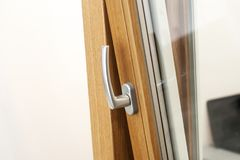 Close up view of open handle in plastic pvc window. Stock Photo