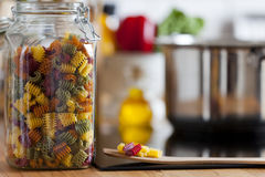 Close up view of an open Storage Jar with colorful Pasta Royalty Free Stock Image
