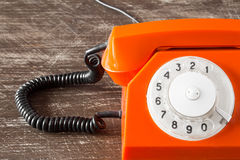 Close up view of orange telephone Stock Photography