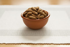 Close up view of organic Almonds in a bowl Royalty Free Stock Photography