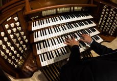 Pipe Organ. Close up view of a organist playing a pipe organ Stock Photo