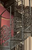 Ornate spiral staircase with patterned ironwork. A close up view of an ornate spiral staircase with patterned ironwork royalty free stock image