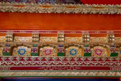 Detail of decorative trim, Likir Buddhist Monastery, India. Close-up view of ornate wood trim - both colorfully painted and carefully carved that surrounds the Stock Image