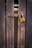 Close up view of a padlock and old wooden door Stock Photos