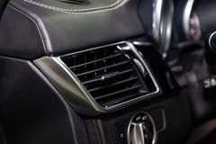 A close-up view of a part of the interior of a modern luxury car with a view of the ventilation deflector of the stove for heating royalty free stock images