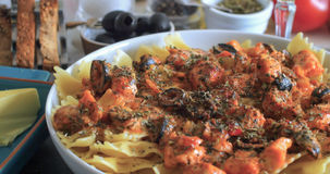 Close up view of pasta with fresh salmon and black olives Royalty Free Stock Photo