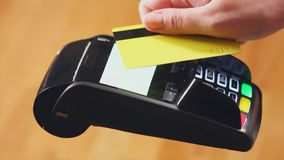 Close up view of payment terminal and credit card with paywave technology stock video