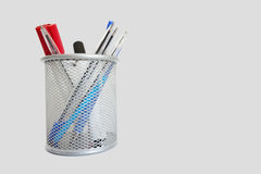 Close-up view of a pen holder over white background Royalty Free Stock Images