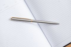 Close up view of pen lying on the notebook Royalty Free Stock Images