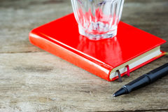 Close-up view of pen and red notebook Royalty Free Stock Photos