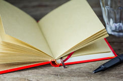 Close-up view of pen and red notebook Royalty Free Stock Photography