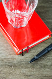 Close-up view of pen and red notebook Stock Image