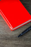 Close-up view of pen and red notebook Royalty Free Stock Image