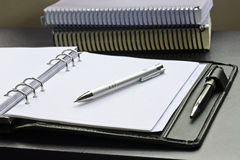 Close-up view of pencil, notepad and books Stock Images