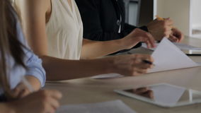 Close-up view of people working with graphics and documents. stock footage