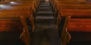 Close up view of pews inside an empty church royalty free stock photos
